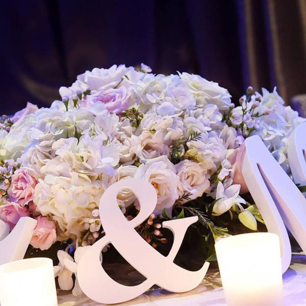 [Image: This enchanting white and pink floral centerpiece would be perfect for any wedding reception. ]